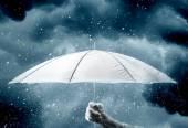 Umbrella in hand under raindrops — Stock Photo