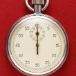Stopwatch on red paper — Stock Photo #63455655