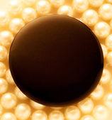 Round badge on pearl — Стоковое фото