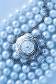 Watch on blue pearl — Stock Photo