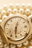 Watch on white pearl — Stock Photo