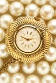 Watch on white pearls — Stock Photo