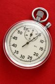 Stopwatch on red paper — Stockfoto