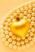 Golden heart on pearls — Stock Photo