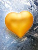Golden  heart on frost — Stock Photo
