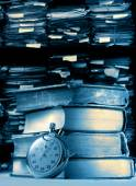 Pile of old books and stopwatch — Stock Photo