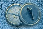Vintage compasses on snowflakes — Стоковое фото