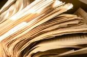 Dirty messy paper documents — Stock Photo
