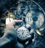 Hand with stopwatch and clockwork inside — Stock Photo