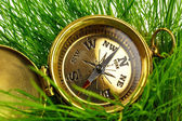 Vintage compass on fresh green grass — Stock Photo