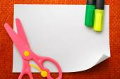 Safe scissors and markers on  paper — Stock Photo