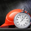 Red safety helmet and stopwatch — Stock Photo #75445463
