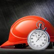 Red safety helmet and stopwatch — Stock Photo #75445215