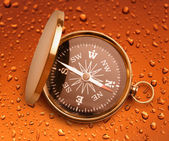 Compass on raindrop background — Stock Photo
