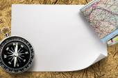 Compass with map on paper — Stock Photo