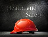 Red safety helmet on steel  — Стоковое фото