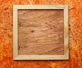 Blank new square wooden frame — Stock Photo