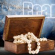 Chest with white pearl necklace — Stock Photo #80375658