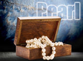 Chest with white pearl necklace — Stock Photo
