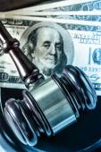 Wooden gavel and dollar banknotes — Stock Photo