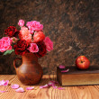 Roses in ceramic vase and books — Stock Photo #53567419