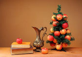 Christmas tree adorned with with apples — Stock Photo