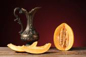Fresh excised melon and carafe of metal — Stock Photo