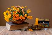 Flowers in wicker baskets, books and jewelry — Stock Photo