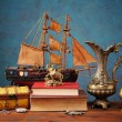 Box for jewelry, books and miniature sailing ship — Stock Photo #60028645