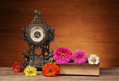 Timer, flowers and books — Stock Photo