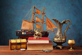 Box for jewelry, books and miniature sailing ship — Stock Photo