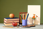 Books, apples, colored pencils and painting canvas — Stock Photo