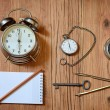 Alarm clock, pocket watch and a compass — Stock Photo #70089367