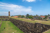 Walls of Galle fort with clock tower in distance — Stock Photo