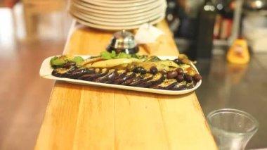 Waiter taking eggplant dish — Stockvideo