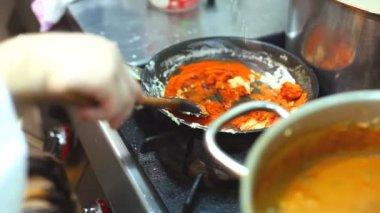 Chef stirring sauce — Stock Video
