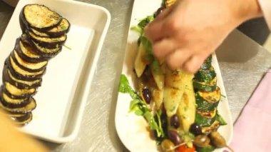 Chef serving eggplant slices — Stockvideo