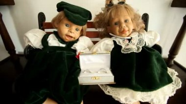 Dolls with wedding rings — Vídeo de stock