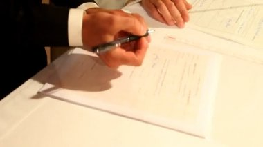 Groom signing wedding document — Stock Video