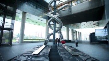People on steel slide — Stockvideo