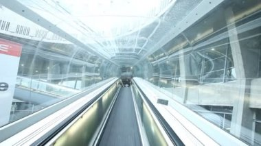 Passing on escalator through glass tube in Charles De Gaulle airport — Stock Video