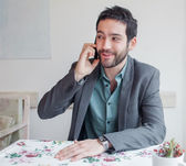 Man in restaurant talking on phone — Stock Photo