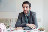 Man wearing jacket sitting in restaurant — Stock Photo