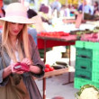 Girl putting away her money at the market — Stock Video #57824883