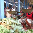 Young local woman selling and people buying at Hikkaduwa market — Stock Video #57892565