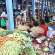 Young local woman selling and people buying at Hikkaduwa market — Stock Video #57894155