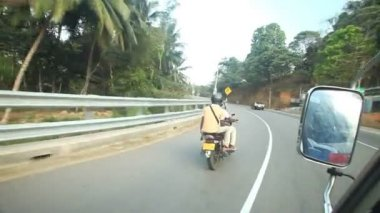 Overtaking motorcyclist from a moving car — Stock Video