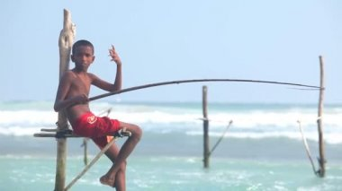 Young boy on a fishing pole — Stock Video
