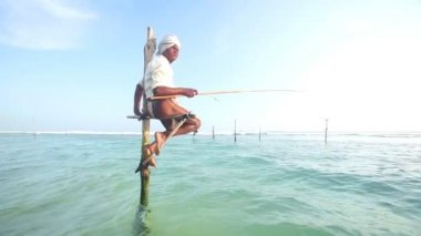 Fisherman on a fishing pole — Stock Video