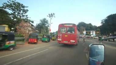 Red bus from a moving car — Video Stock